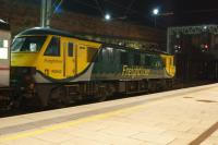 Freightliner 90042 waits at the north end of platform 4 at Preston in the early hours of 16 July 2016. The loco is one of the Freightliner Class 90s on hire to GBRF in order to work the Caledonian Sleeper services. This particular service was the 1S25 Highland Sleeper which normally runs from Euston to Inverness with some coaches coming off at Edinburgh for Aberdeen and Fort William however on this morning the main portion was only advertised to Perth.