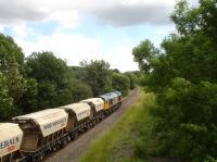 GBRf 66749 heads south along the former four track Midland Main line, shortly after passing the former Sandal & Walton station site, with a cargo of silica sand from Middleton Towers in Norfolk destined for the glassworks at Monk Bretton near Barnsley. The section of track forward of the loco originally ran through a tunnel, but was opened up when the line was increased from two tracks to four.