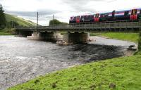 The 1309 Glasgow Central – Manchester Airport southbound across the Clyde over  Lamington Viaduct on 27 July 2016. Note the rebuilt piers and other repairs carried out following damage caused by storm <I>Frank</I> at the beginning of the year, which resulted in closure of the west coast main line for more than seven weeks. The train was running at what appeared to be normal line speed – certainly a lot faster than its sister unit was on reopening day on 22 February. [See image 54263] <br><br>[John Furnevel&nbsp;27/07/2016]