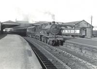 A train from Winton Pier calls at Ardrossan town on 6 July 1959 with a service for Kilmarnock. The locomotive is Hurlford shed's 2P 4-4-0 no 40689.  <br><br>[G H Robin collection by courtesy of the Mitchell Library, Glasgow&nbsp;06/07/1959]