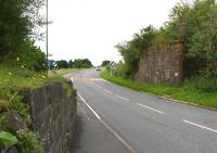 Remains of the railway bridge that once carried the Moffat branch over the A701 on its one and a half mile journey from the junction with the WCML north of Beattock. Moffat station closed to passengers in 1954, with the branch closing completely 10 years later. View is south towards Beattock on 27 July 2016. The last passenger train to cross the bridge was the SLS Easter Railtour of 29 March 1964 [see image 30082].<br><br>[John Furnevel&nbsp;27/07/2016]