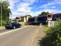 The level crossing at Cornton on 1st August 2016. Network Rail is seeking to close the existing vehicle and foot crossings at Cornton and replace them with a road bridge incorporating pedestrian and cycle access before the railway through Stirling is electrified in 2019. Plans were unveiled at two local public meetings in June 2016. <br> <br><br>[Colin McDonald&nbsp;01/08/2016]
