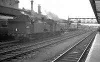 A DMU leaving Doncaster southbound on 29 July 1961 passes J50 0-6-0Ts 68917 and 68928 standing on the centre road. <br><br>[K A Gray&nbsp;29/07/1961]