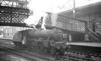 45742 <I>'Connaught'</I> standing under the footbridge on the centre road at Carlisle on 26 October 1964. The Jubilee is waiting to relieve the locomotive off the incoming 9.25am Crewe - Perth.<br><br>[K A Gray&nbsp;26/10/1964]