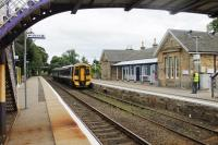158710, on a service from Inverness to Ardgay, draws to a stand alongside the station building at Tain, now converted into the recently opened and excellent <I>Platform 1864</I> restaurant that has won Railway Heritage awards for the tasteful building conversion.<br><br>[Mark Bartlett&nbsp;22/07/2016]