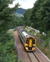 The 1054 Edinburgh - Tweedbank passing the site of Selkirk Junction on 4 August 2016 shortly after leaving Galashiels. [See image 48213]<br><br>[John Furnevel&nbsp;04/08/2016]