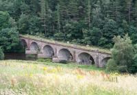 The 1863 Neidpath Viaduct which carried the Symington, Biggar and Broughton Railway across the Tweed a mile west of Peebles. Photographed on 4 August 2016 looking south east from alongside the A72.<br><br>[John Furnevel&nbsp;04/08/2016]