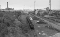 Looking north over the east side of British Steel Ravenscraig post closure. This was the iron ore unloading yard with the stockyard to the right and the sinter plant in the distant left. The Wishaw Deviation of the WCML is to the left.<br> <br><br>[Bill Roberton&nbsp;01/08/1992]