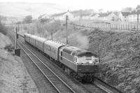 A Type 2 with an up stopping train passing through Langlee in April 1963 shortly after leaving Galashiels station.<br><br>[Dougie Squance (Courtesy Bruce McCartney)&nbsp;/04/1963]