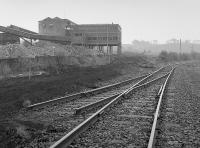 A 1988 visit finds the Dunaskin Central Washer (known as the Burnton Washer) soon to be demolished with the disused Culter sidings to the right. The washery sidings and lifted and the 'new' Chalmerston line has not yet been laid.<br><br>[Bill Roberton&nbsp;//1988]
