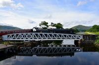 Black 5 No.45407 is reflected in the Caledonian Canal as it crosses the swing bridge at Banavie at the start of the journey to Mallaig.<br><br>[John Gray&nbsp;02/08/2016]