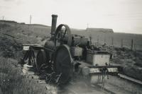 Old locomotive at Longmorn Distillery in 1951. This was in the siding at the north end of the station, the 'main line' being seen just to the right. The 2-2-0 at the buffer is McLaren no. 614 of 1898, recorded as scrapped in 1949.<br><br>[Alec Unsworth (Courtesy Chris Unsworth)&nbsp;//1951]