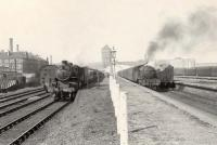 Trains at the Singer Workers Platforms on 12 April 1958, looking west back towards the factory. The locomotives are Ivatt 4MT 2-6-0 43136 and Gresley V3 2-6-2T 67604.  <br><br>[G H Robin collection by courtesy of the Mitchell Library, Glasgow&nbsp;12/04/1958]