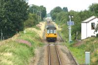 A Preston to Ormskirk service crosses Pages LC as it approaches the camera on 09 August 2016. In the background a car crosses at Midge Hall LC and the semaphore signal protecting it can just be made out to the left of the rear of the train.<br><br>[John McIntyre&nbsp;09/08/2016]