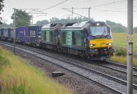 DRS 68004 and 68017 with the Tesco Daventry - Mossend service at Fiddlers Gill, south of Braidwood.<br><br>[Bill Roberton&nbsp;12/08/2016]