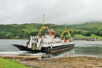 MV <I>Loch Dunvegan</I> pulls away from the slipway at Rhubodach to cross the Kyle of Bute to Colintraive. The vessel was made redundant from its original route by the Skye Bridge. [See image 54270] for an elevated view of the same location. <br><br>[Mark Bartlett&nbsp;25/07/2016]
