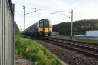 A Trans Pennine service from Edinburgh to Manchester Airport on 13 August 2016 passes the site of the former Coppull station on the WCML between Preston and Wigan.<br><br>[John McIntyre&nbsp;13/08/2016]