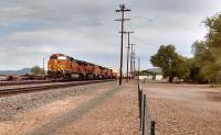 Five diesel locomotives working in multiple haul a seventy nine wagon train of double deck containers through Seligman, formerly a junction on the Santa Fe Railroad in Arizona. Photo by Mark Edwards 30th July 2016<br><br>[Mark Bartlett Collection&nbsp;30/07/2016]