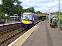 A Class 170 DMU approaches the 1985 Bridge of Allan station from Dunblane. There is a currently a TACTRAN proposal in development to relocate to station further south, nearer to Cornton and Causewayhead. <br><br>[Colin McDonald 01/08/2016]