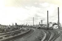 View over Ardrossan North station in August 1960, looking towards the harbour. The station had closed to passengers in 1932. [See image 51717]<br><br>[G H Robin collection by courtesy of the Mitchell Library, Glasgow&nbsp;24/08/1960]