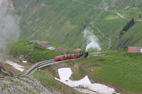 RB No.12, waiting in Oberstafel loop to climb the final section to the Rothorn summit, is seen from a descending train on 20th June 2016. Only an hour before as we went up the mountain this spot had been completely in dense cloud.<br><br>[Mark Bartlett&nbsp;20/06/2016]