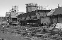 Derwenthaugh Coke Works on 21 April 1986, closed the previous year, served by the Chopwell & Garesfield Railway<br> <br> Coke oven locomotive with elevated cab and a coking car.<br><br>[Bill Roberton&nbsp;21/04/1986]