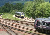 Scene to the north of Stirling station on the afternoon of 12 June 2008. In the background a train from Glasgow Queen Street turns north east on the last leg of its journey to Alloa, while in the foreground a Dunblane - Edinburgh train is slowing for the Stirling stop.<br><br>[John Furnevel&nbsp;12/06/2008]