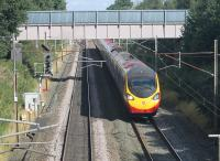 An Edinburgh to Euston Pendolino heads towards Preston near Barton and Broughton on 29th August 2016. The signal on the left controls access to the Down Loop, which can just be seen under the bridge that carries a local water main. This stretch of the WCML had four tracks until around the time of electrification in the early 1970s. [Ref query 3350]  <br><br>[Mark Bartlett&nbsp;29/08/2016]