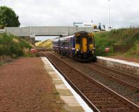 A very <I>short</I> encounter with 156449 passing through the station at speed. In the background is the replacement A706 Road Bridge which was due to open later that day.<br><br>[Colin McDonald 31/08/2016]