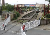 Signalman's view of Ramsbottom level crossing and the station on 3rd August 2016 as the gates are closed across the road to allow a DMU to depart for Rawtenstall. View from the cabin taken during a supervised visit. <br><br>[Mark Bartlett&nbsp;03/08/2016]