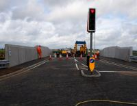 Contractors put the finishing touches to the replacement A706 overbridge at Breich Station. The bridge was due to open later that day and is one of 17 to be replaced prior to electrification.<br><br>[Colin McDonald 31/08/2016]