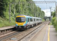 Sporting the revised livery that will be applied to the new trains on order for Trans-Pennine, 185108 passes through Heald Green on 17th June 2016. The train is signalled for the sharp right turn onto the Airport branch, just beyond the bridge. <br><br>[Mark Bartlett&nbsp;17/06/2016]