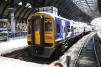 Northern 158906 stands in a sunny bay platform 6 at York on 22 April 2009 awaiting its departure time with an early afternoon service to Blackpool North. <br><br>[John Furnevel&nbsp;22/04/2009]