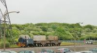 Sentinel 4wDM Shunter H055 (10037/1960) is propelling two nuclear flask wagons towards a loading point at Heysham Power Station on 26th May 2016. The Land Rover ahead of the train is protecting an ungated level crossing. NOTE: The power stations are a licensed nuclear site where photography is restricted. This picture taken with the kind permission of EDF-Energy and the Civil Nuclear Constabulary. <br><br>[Mark Bartlett&nbsp;26/05/2016]