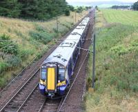 ScotRail 380110 heads north from Carstairs East Junction shortly after the Carstairs stop on 31 July 2016 with the 0831 Ayr - Edinburgh via Glasgow Central.<br><br>[John Furnevel&nbsp;31/07/2016]