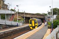 The 1019 to Glasgow Central arrives at Shotts on an overcast day in August 2016. Despite the absence in this view of any obvious signs of the pre-electrification work, preparations are well in hand. Behind the camera at the end of platform one there is now a sizeable contractor's compound with an access point for the bridge replacement work.<br><br>[Colin McDonald&nbsp;31/08/2016]
