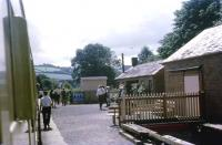 A train from Buckfastleigh calls at Staverton on the Dart Valley Railway on the afternoon of 30 July 1969. At that time the train continued south towards Totnes but there was neither access to the BR station, nor had the DVR built their own station at Totnes Riverside, so push-pull working was a distinct advantage.<br><br>[John McIntyre&nbsp;30/07/1969]