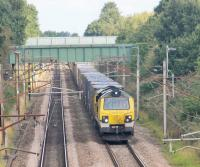 Freightliner 70005 and the Coatbridge to Daventry containers head south at Barton & Broughton on the August Bank Holiday, 2016. This image taken from the bridge that carries the <I>Guild Wheel</I> over the WCML. The Guild Wheel is a 21 mile circular cycle route around the City of Preston. Its other WCML crossing is under the Ribble Viaduct immediately south of Preston Station.  <br><br>[Mark Bartlett&nbsp;29/08/2016]
