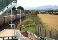 Looking west along the ECML towards Edinburgh from the station footbridge at Wallyford on 7 September 2016. The passing train is the 1326 Oxwellmains – Powderhall empty 'Binliner', hauled by 67009.   <br><br>[John Furnevel&nbsp;07/09/2016]