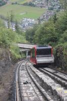 View from a descending car of its counterpart at the passing loop of the Harder Kulm Funicular. This climbs steeply from adjacent to Interlaken Ost station, the canopies of which are visible top left in this picture. [See image 56012] for the view of Interlaken West from the top station.   <br><br>[Mark Bartlett&nbsp;19/06/2016]