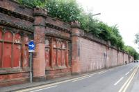 The hanging gardens of Dumbarton. This is the disused eastbound platform at Dumbarton Central viewed from the north west. It was platform 4 at time of track lifting. In the subsequent renumbering the remaining eastbound platform became platform 1.<br><br>[Ewan Crawford&nbsp;29/07/2016]