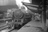 Britannia Pacific no 70035 <I>Rudyard Kipling</I> waits with a northbound train at Carlisle platform 3 in the early 1960s.<br><br>[K A Gray&nbsp;//]