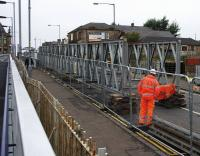 The temporary bridge which will carry pedestrians and diverted utility services across the railway takes shape on the condemned Station Road overbridge at Shotts. It is due to be craned in to position on 18th September.<br><br>[Colin McDonald&nbsp;14/09/2016]