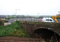 View south at Station Road overbridge in Shotts. The temporary bridge which will carry pedestrians and diverted utility services across the railway is being assembled on the closed roadway. The foundations for the south side of the temporary bridge can be seen on the left.<br><br>[Colin McDonald&nbsp;14/09/2016]