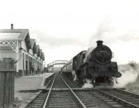 BR Standard tank 80121 prepares to leave Tillynaught Junction in the summer of 1960 with a train for Elgin via the coast.<br><br>[G H Robin collection by courtesy of the Mitchell Library, Glasgow&nbsp;18/08/1960]