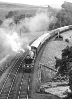 Train 1X75, the South & West Railway Society Euston – Aberdeen <I>Granite City</I>, approaching Bowshank Tunnel behind V2 60836 on 3 September 1966. Various locomotives were used during the trip, with 60836 handling the Carlisle – Edinburgh leg, following which A2 60532 <I>Blue Peter</I> took over for the journey to Aberdeen via the Glenfarg route [see image 20700]. The special returned south the following day via the ECML, terminating at Kings Cross.  <br><br>[Dougie Squance (Courtesy Bruce McCartney)&nbsp;03/09/1966]