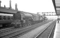 A trio of steam locomotives moves north through Doncaster station on the centre road in 1961. Bringing up the rear of the group is A1 Pacific no 60140 <I>Balmoral</I><br><br>[K A Gray&nbsp;//1961]