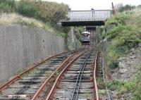 The gauge of the Aberystwyth Cliff Railway appears to be variable and there are some noticeably uneven rail joints. The line also performs something of a <I>switchback</I> too rather than a steady climb. This is the view towards the upper station on Constitution Hill from an ascending car approaching the slight divergence at the passing point on 18th September 2016.<br><br>[Mark Bartlett&nbsp;18/09/2016]