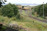 Leith South yard on 7 September 2016, seen from the high level trackbed of the Caledonian Leith East Goods branch. No signs of recent life in the yard, with the vehicles in the foreground alongside the south wall having become rather overgrown since they first arrived some 10 years ago. [See image 13862]. <br><br>[John Furnevel&nbsp;07/09/2016]