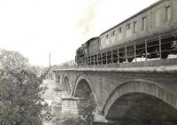A Blackpool - Glasgow train crossing the 1849 Martinton Bridge over the Nith north of Dumfries station on a summer Saturday in 1961. The locomotive is Patriot Class 4-6-0 45507 <I>Royal Tank Corps</I>. <br><br>[G H Robin collection by courtesy of the Mitchell Library, Glasgow&nbsp;15/07/1961]